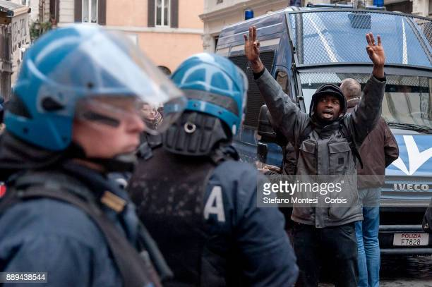 The police block the Movement for the right to housing and migrants during a demonstration against Lega Nord party leader Matteo Salvini on December...