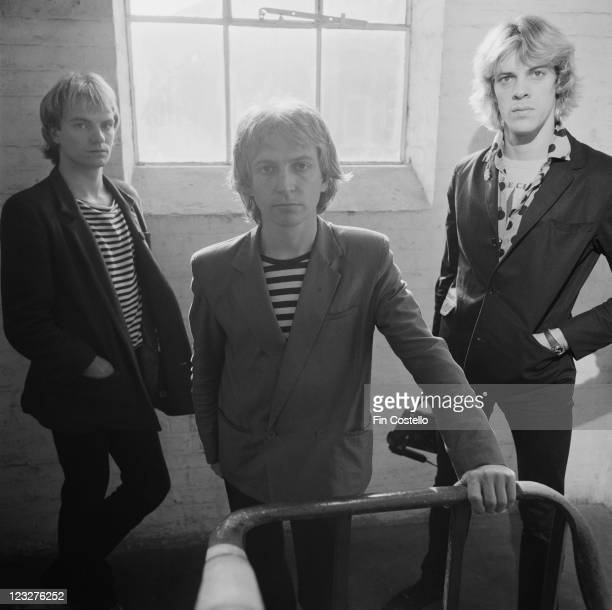 The Police British rock band pose by a window on a stairwell for group portrait United Kingdom circa 1979