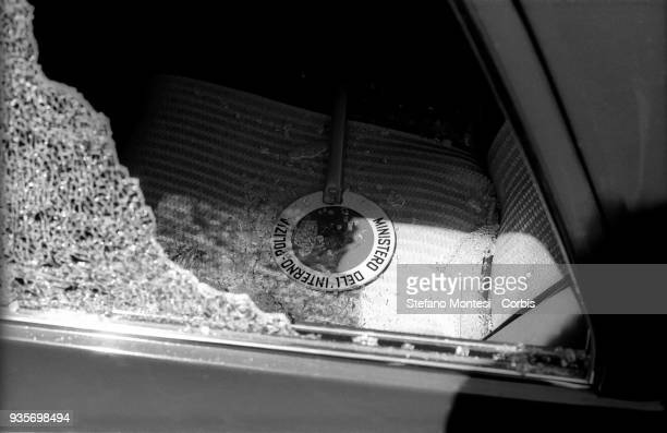 The police car hit by the bullets of the Red Brigades bombers during the attack on the provincial headquarters of the Christian Democrats in Nicosia...