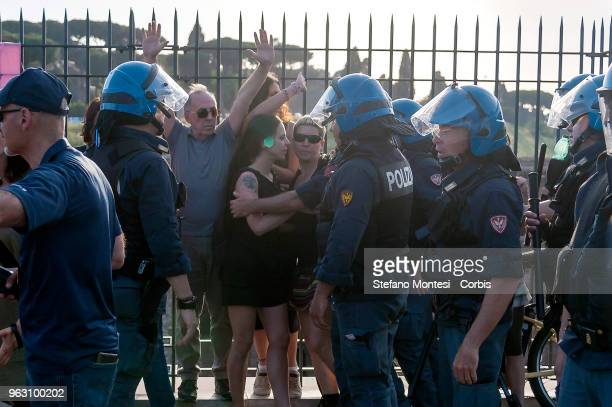 The police charge proPalestine protesters demonstrating at the Tour of Italy cycling race after it started in Israel on May 27 2018 in Rome Italy The...
