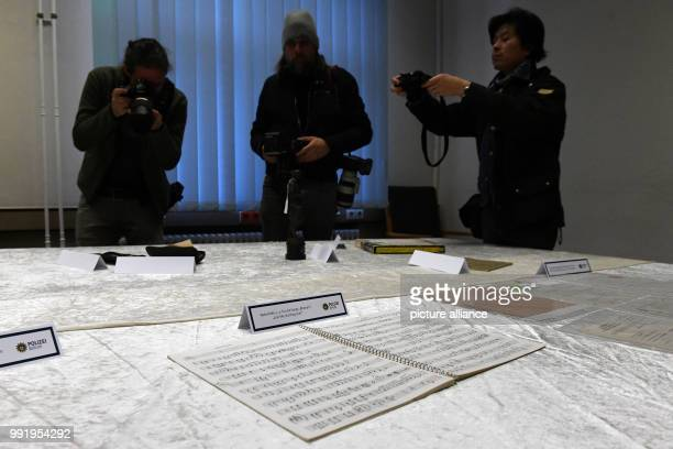 The police department of Berlin shows a stolen music book of Beatles musician John Lennon during a press conference in Berlin, Germany, 21 November...