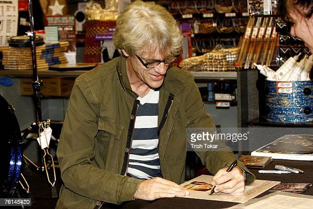 The Police drummer Stewart Copeland signs autographs at the Guitar Center to promote his new solo release The Stewart Copeland Anthology on August 16...