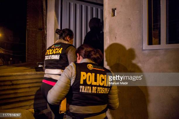 The police enter the house of a man arrested during a special operation by the Human Trafficking and Smuggling of Migrants Division of the Peruvian...