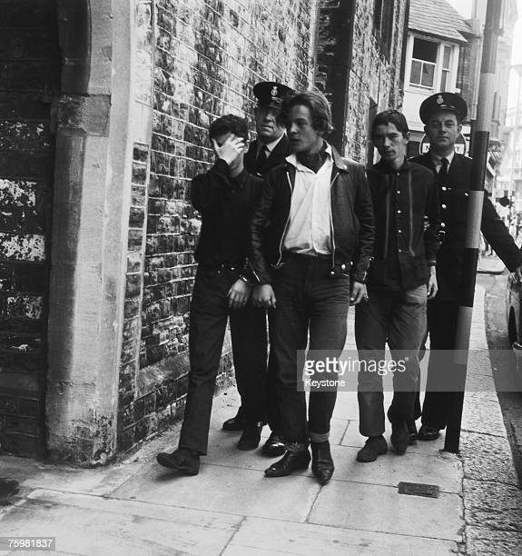 The police escort three young Rockers to court after trouble broke out between Mods and Rockers in Hastings East Sussex 4th August 1964
