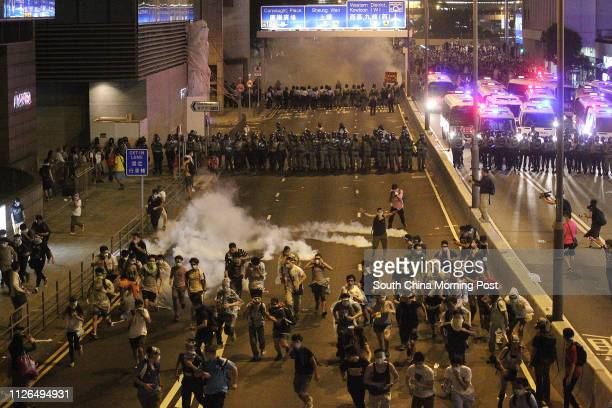 The police fire tear gas to protesters at Connaught Road Central outside AIA Central building in Central after 'Occupy Central' was officially...
