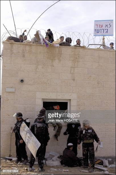 The police force demonstrators out of the houses to be destroyed