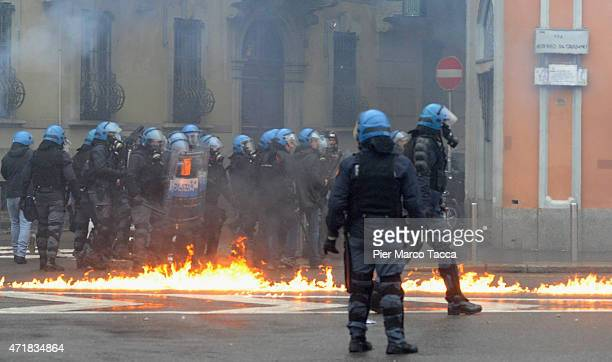 The police gather during the demonstration against Expo 2015 at Milano on May 1 2015 in Milan ItalyThe traditional parade of May 1 to Labor Day...