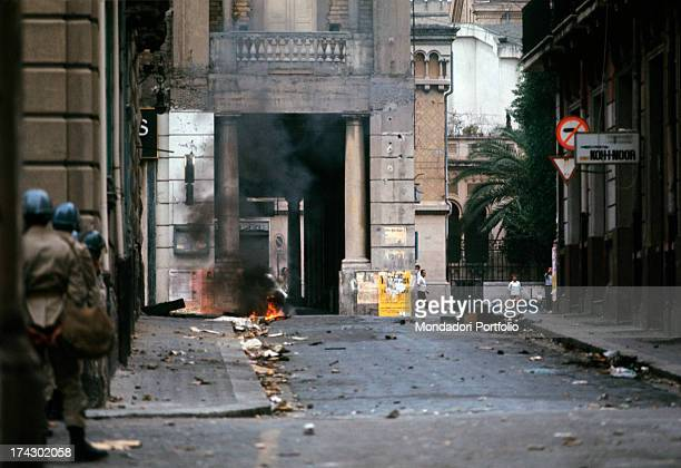 The police guard a road of the centre of Reggio Calabria where there is unrest due to the decision of the provincial capital. Reggio Calabria,...