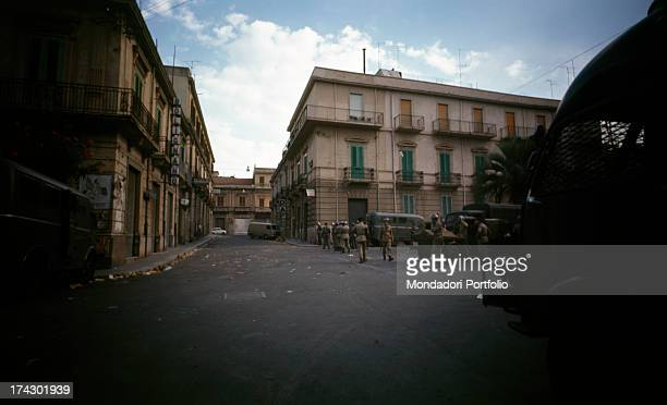 The police guarding a deserted road of central Calabria where there have been disturbances due to the decision taken by the provincial capital Reggio...