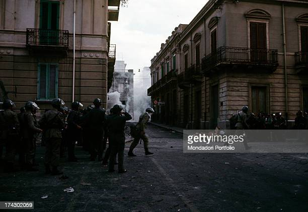 The police guarding a road in the centre of Reggio Calabria where there are disturbances due to the decision taken by the regional capital. Reggio...