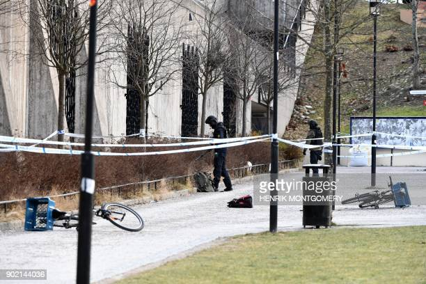 The police has cordoned off and investigates the area outside Varby Gard metro station south of Stockholm where two people were injured in an...
