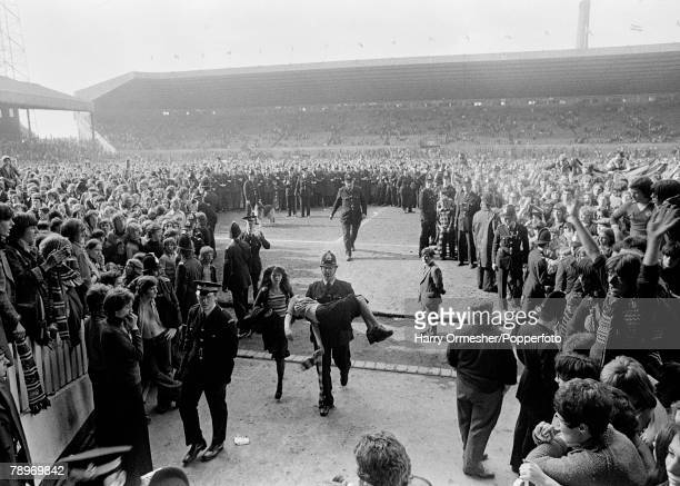 Sport Football Division 2 Old Trafford Manchester 26th April 1975 Manchester United 4 v Blackpool 0 Policeman carries a young girl to safety in the...