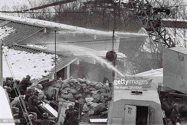 The police hoses water at the Asama Sanso holiday lodge where the United Red Army is taking a hostage on February 24 1972 in Karuizawa Nagano Japan...