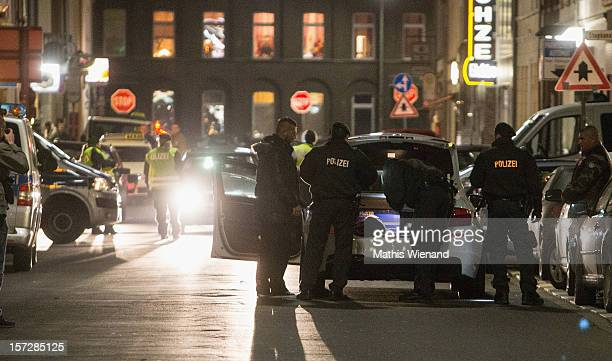 The Police inspect a car before the Hells Angels Press Conference on November 30 2012 in Krefeld Germany The 30 former Bandidos came from chapters in...