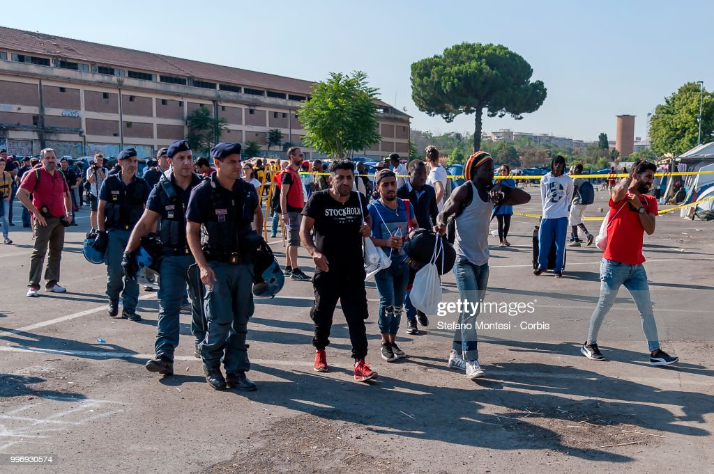 The police intervene to control the migrants in the makeshift camp for migrants and refugees, at the end of the control, 35 migrants were taken to the Police Immigration Office for further checks on July 12, 2018 in Rome, Italy. About three hundred African, Kurdish and Eritrean migrants live in the Baobab migration centre, a makeshift camp of about 200 tents and shacks near Tiburtina train station without water, electricity and toilets.