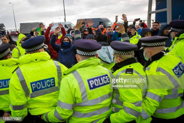 The Police line as tensions are high between police and drivers who have been waiting over 48 hours for the Port of Dover to re-open, on the 23rd of...