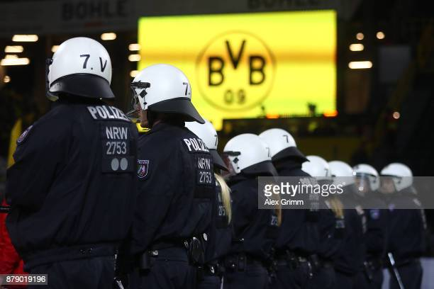 The police lines up in front of the supporters of Dortmund after the Bundesliga match between Borussia Dortmund and FC Schalke 04 at Signal Iduna...