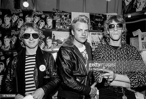 The Police LR_ Andy Summers Sting and Stewart Copeland pose at an instore appearance in Berkeley California March 5 1979