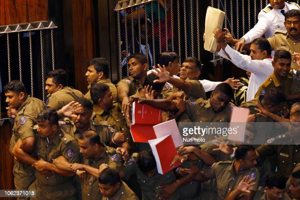 The police officers who escort and provide protection for the speaker Karu Jayasuriya are hit with Text books with reference to the constitution by...