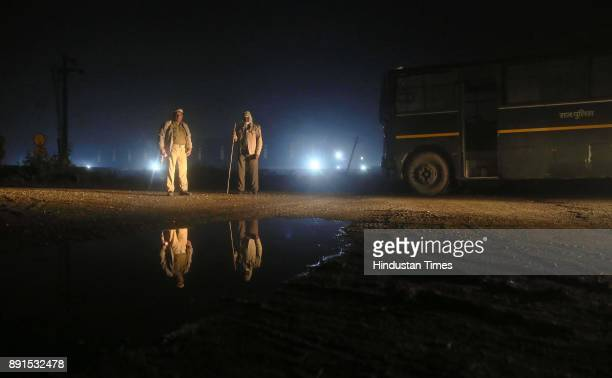The Police official on duty near their bus at the anticow smuggling Mobile Police Post at Amalaki at Bhiwadi on intervening night of December 11 and...