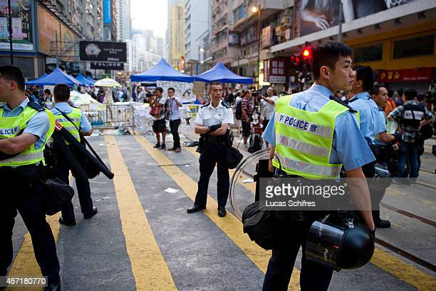 The police re-opened traffic lanes in Causeway Bay on October 14, 2014 in Hong Kong. At 6 AM on October 14, police surrounded the pro-democracy...