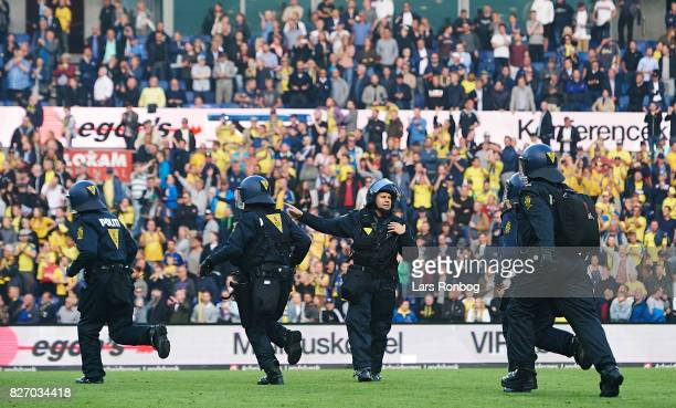 The police running on to the pitch to stop fans of FC Copenhagen during the Danish Alka Superliga match between Brondby IF and FC Copenhagen at...