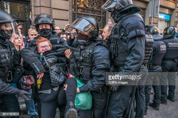The police seen arresting a woman during clashes between protesters and the police Hundreds of Catalan independence supporters blocked the adjacent...