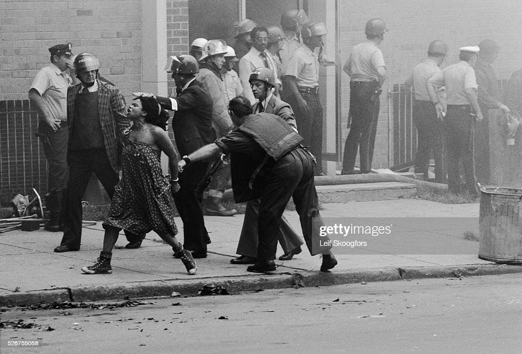 The police use extreme force when they attack the MOVE cult headquarters in the Powelton Village section of Philadelphia, Pennsylvania.