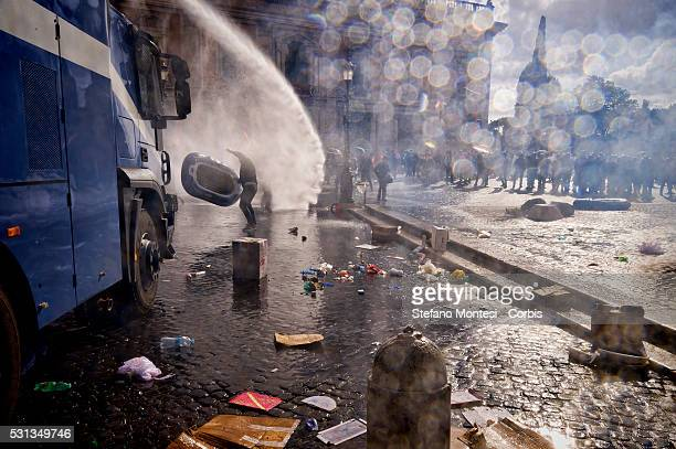 The police use water cannons against protesters during the demonstration by the movements for the right to housing against the policy of evictions...