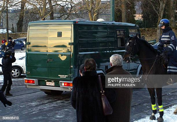 The police van transporting Belgian Marc Dutroux leaves with an unclosed backdoor 01 March 2004 the Arlon court at the end of the first day of his...