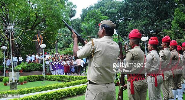 The policeman offers a gun salute to honour to Freedom fighter Chandra Shekhar Azad on his 109th birthday anniversary at Azad Park in Allahabad Azad...