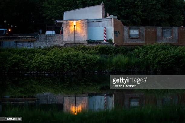 The polish boundary post of the polish town Zgorzelec is pictured during blue hour from the german nearby town Goerlitz on May 18, 2020 in Goerlitz,...