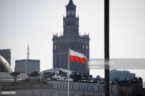 The Polish flag is seen waiving with the well known city symbol the Palace of Culture and Sciences in the background in Warsaw Poland on March 17 2018