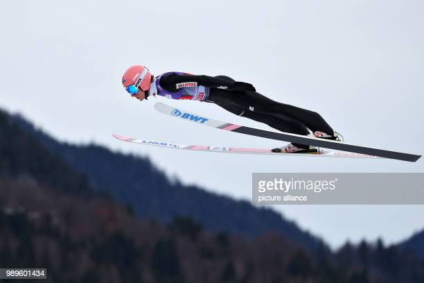 The Polish ski jumper Dawid Kubacki trains his jump during the trial round of the Four Hills Tournament in GarmischPartenkirchen Germany 01 January...