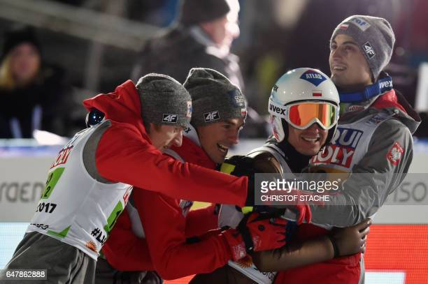 The Polish team celebrates after the Men's Large Hill Team Ski Jumping event of the 2017 FIS Nordic World Ski Championships in Lahti, Finland, on...