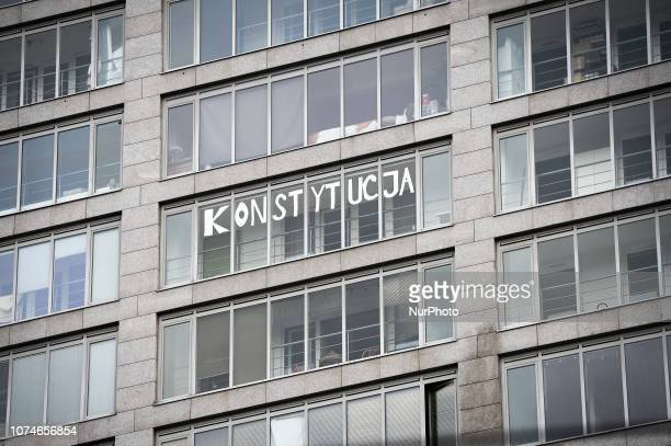 The Polish word for constitution is seen in cut out letters on windows of a high rise building in Warsaw Poland on December 15 2018 Konstytucja has...