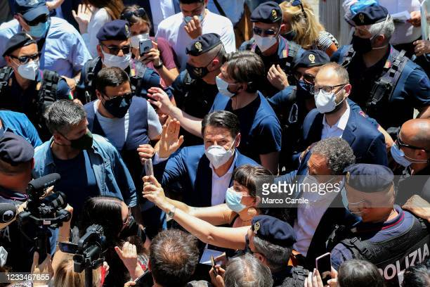The political leader of the 5 Star Movement, Giuseppe Conte, with a mask to protect himself from Covid-19, takes a selfie with one of his supporters...
