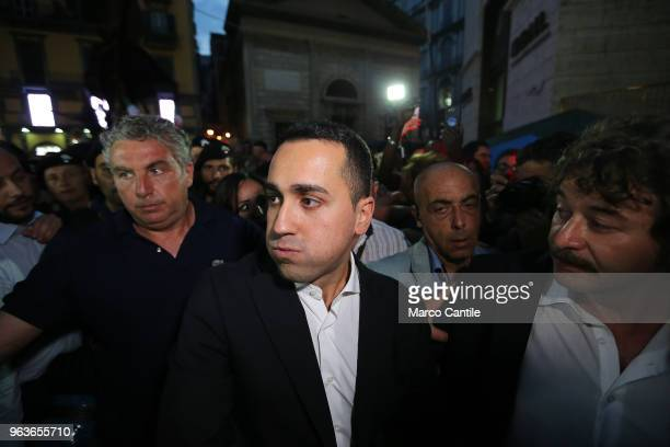 The political leader of the 5 Star Movement Luigi Di Maio during a rally in Naples greets his supporters