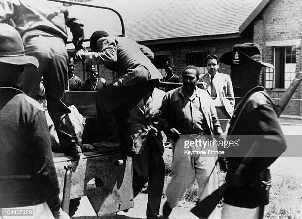 The politician Jomo KENYATTA and five people accused of being members of the MauMau revolt being taken back to prison after the court adjourned the...
