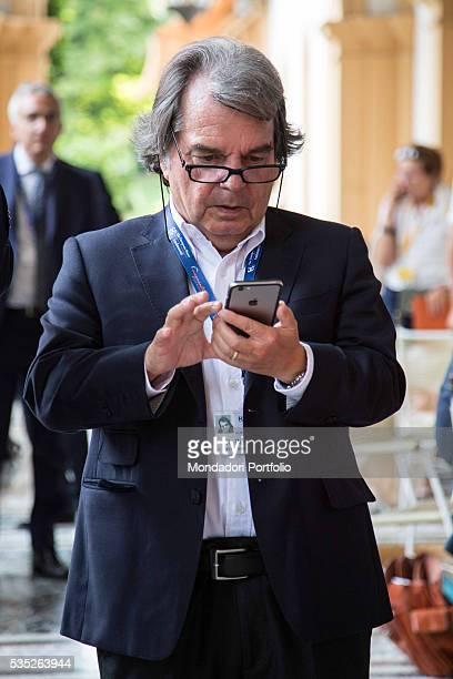 The politician Renato Brunetta in a Bottega del Sarto suit looking at his cell phone at the Forum Ambrosetti in Villa d'Este Cernobbio Italy 4th...