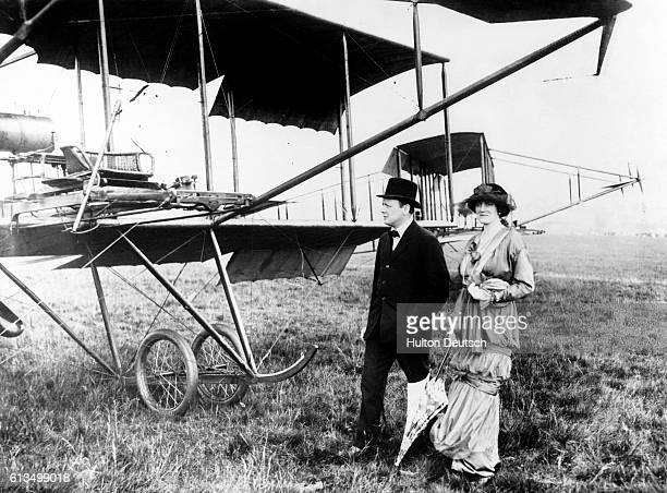 The politician Winston Churchill with his wife Clementine beside an early aircraft at Hendon 1914