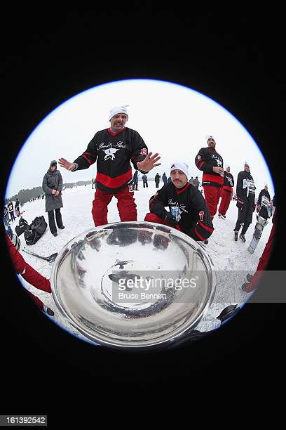 The Pond Stars celebrate thir victory in the 2013 USA Hockey Pond Hockey National Championships on February 10 2013 in Eagle River Wisconsin The...