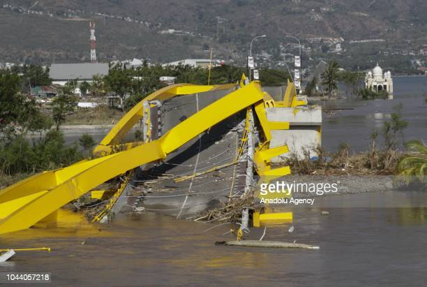 The Ponolele bridge that connects East Palu and West Palu collapsed after the earthquake and tsunami waves on the Talise beach area is seen in Palu...