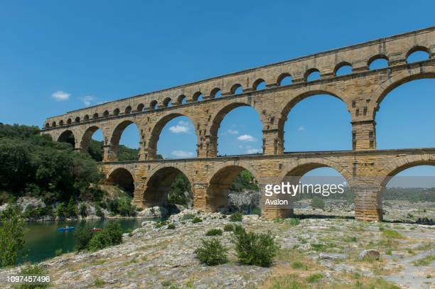 The Pont du Gard , an ancient Roman aqueduct that crosses the Gardon River, near Nimes in the south of France.