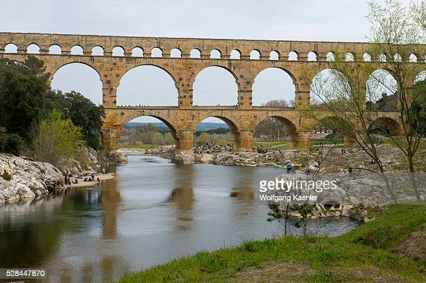The Pont du Gard built in the first century AD is an ancient Roman aqueduct that crosses the Gardon River in the south of France and is 49 m high...