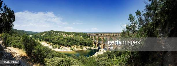 the pont du gard (panorama) - famous ancient roman aqueduct crosses gardon river (gard/ france) - languedoc rousillon stock pictures, royalty-free photos & images