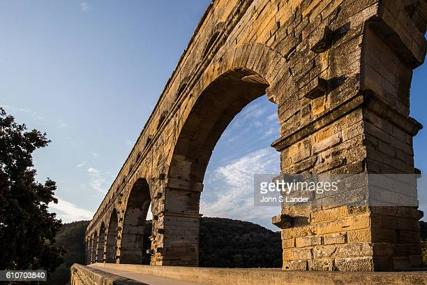 The Pont du Gard was built to allow the aqueduct of Nimes which is almost 50 km long to cross the Gard river Roman architects and engineers who...