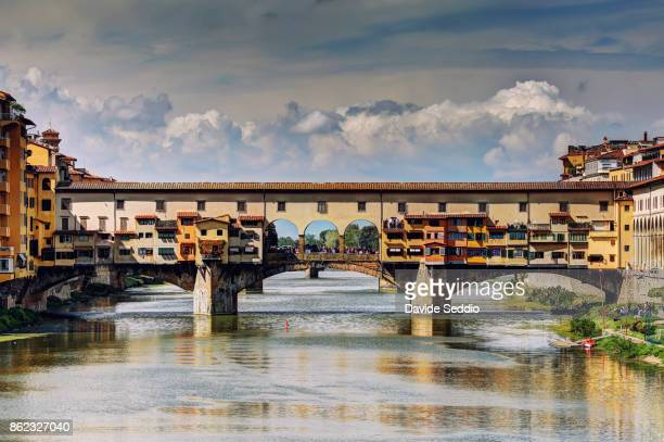 the ponte vecchio (old bridge) viewed from ponte alle grazie - ponte vecchio stock photos and pictures