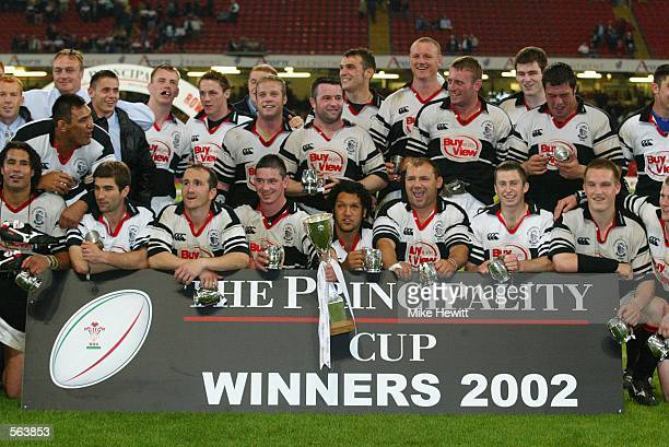 The Pontypridd team celebrates with the trophy after the Principality Cup Final between Llanelli and Pontypridd at The Millennium Stadium, Cardiff on...
