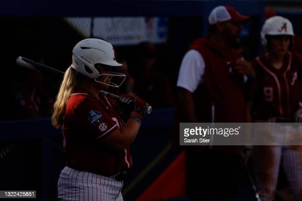 The ponytail of Maddie Morgan shines in the sunlight before her at-bat during the third inning of Game 14 of the Women's College World Series against...